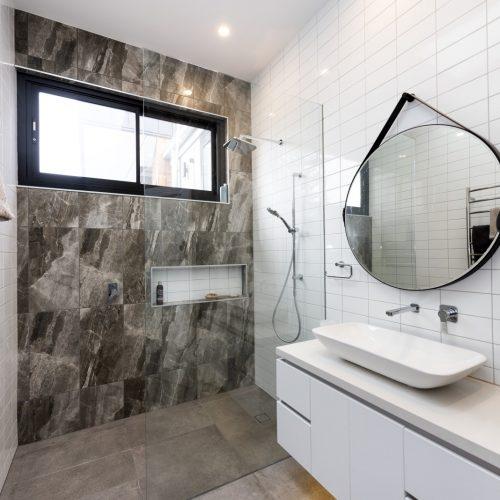 frameless shower screen, mirrors, natural light